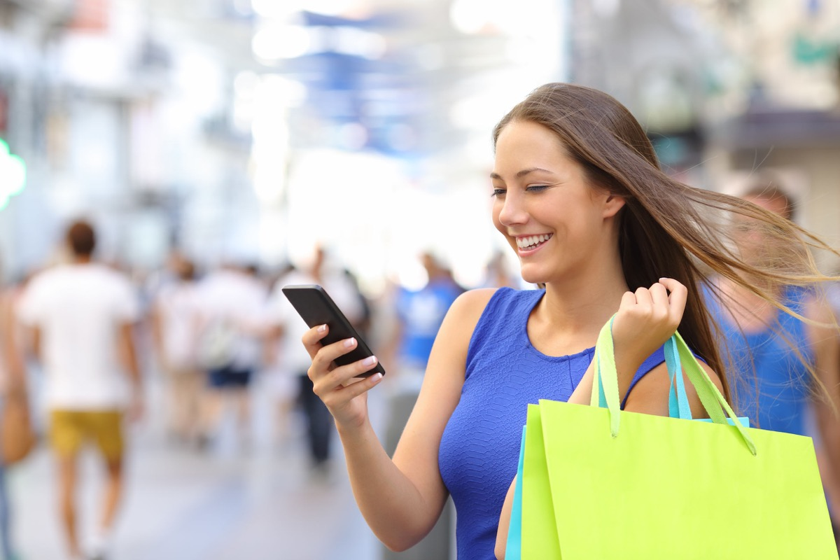 Shopper woman shopping with a smartphone, representing mobile marketing