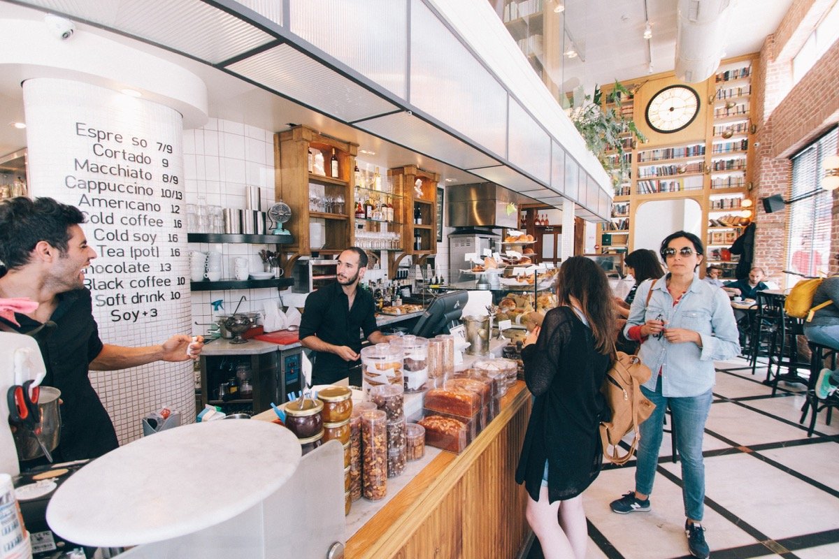 interior of a busy coffeeshop; new location concept